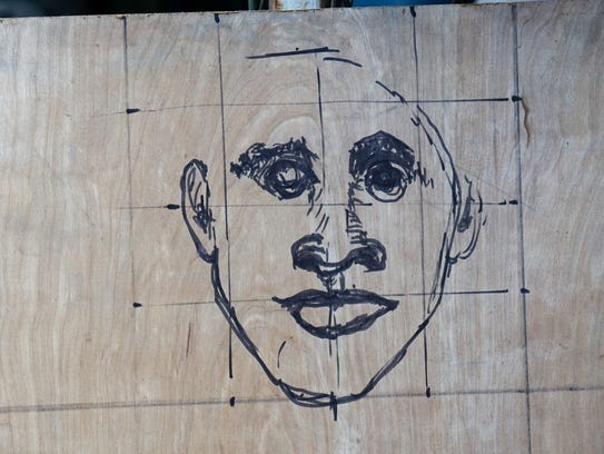 Steel sculptor Russel Whiting sketched the face of
