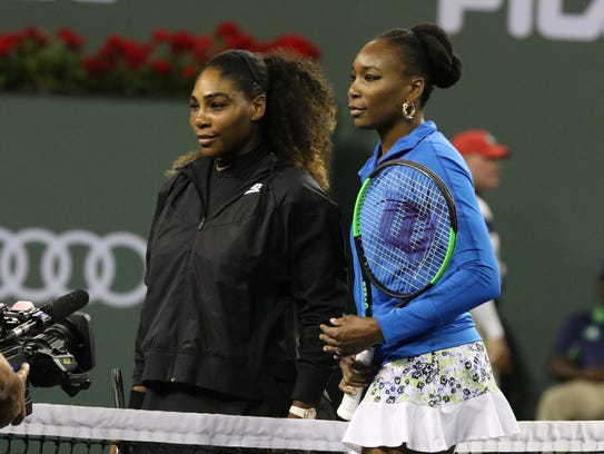 Serena Williams, left, and Venus Williams stand together