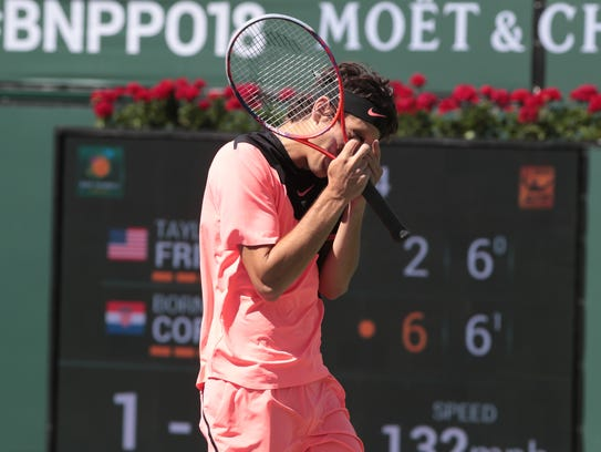 Taylor Fritz reacts with frustration to a point in