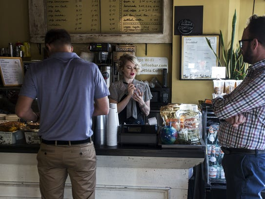 Devon Kellogg takes customers' orders at Lola Coffee