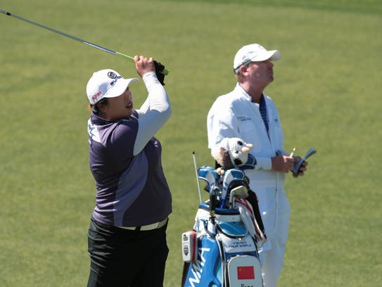 Shanshan Feng plays during the pro-am tournament on