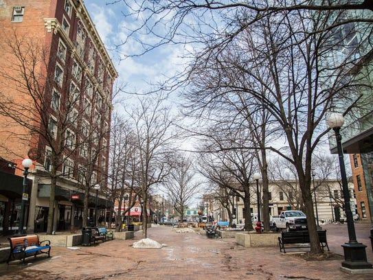 People make their way through Iowa City's pedestrian