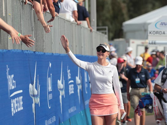Jessica Korda gives fans high fives on the way to the