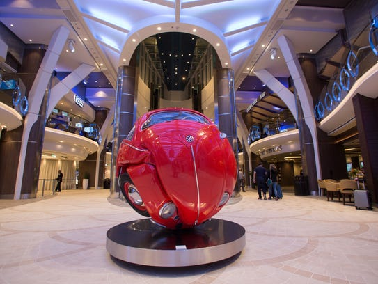 Royal Caribbean's Symphony of the Seas features an interior mall-like area called Royal Promenade with shops, bars and eateries (plus a sculpture by Ichwan Noor called Beetle Sphere).