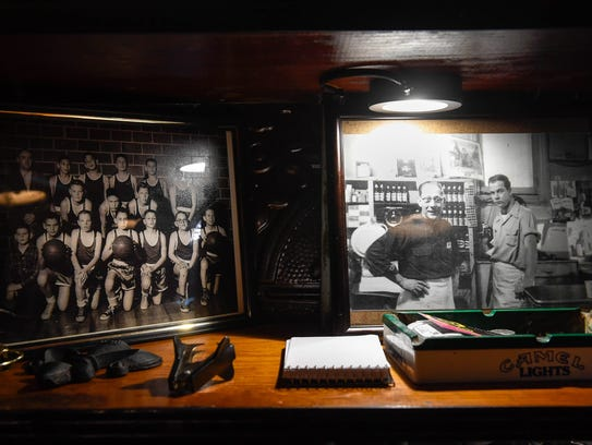 Photos on the shelves at Henderson's historic Metzger's