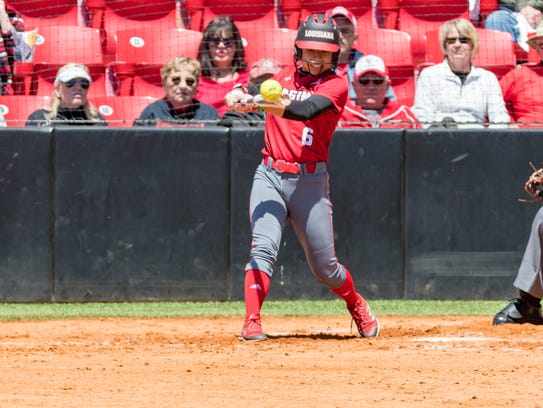 UL's Brittany Rodriguez hits a ball through the left side for a hit during the Cajuns' doubleheader split with Texas State on Sunday at Lamson Park.
