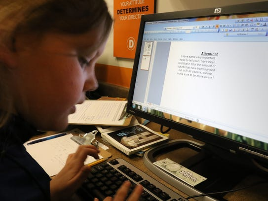 Sophia Collins, a St. Mary's of Hales Corners fourth grader, writes a story for the BizTown Gazette newspaper at the Junior Achievement Kohl's Education Center's BizTown on April 19.