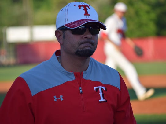 Tioga coach Dave Montiel walks to the dugout after