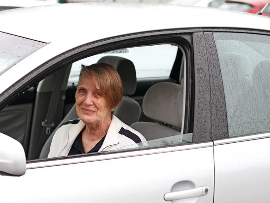 Goodwill employee Carolyn Smith in her 'new' car she