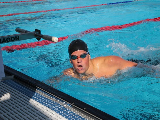 Cody Meyer wins the 200 freestyle at the Desert Valley