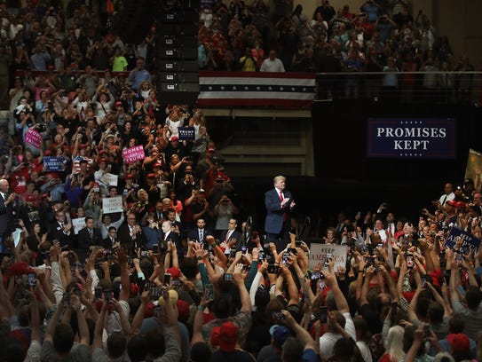 President Donald Trump speaks to supporters at a campaign