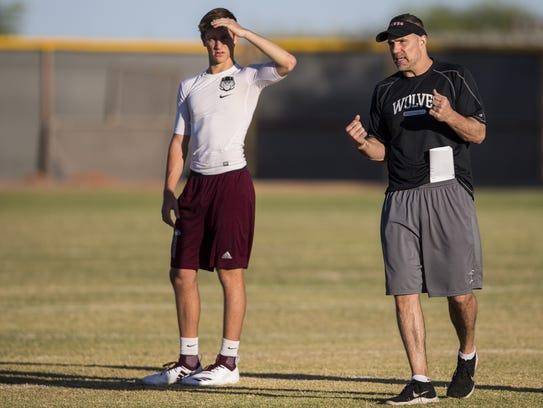 Desert Mountain quarterback Kedon Slovis listens to