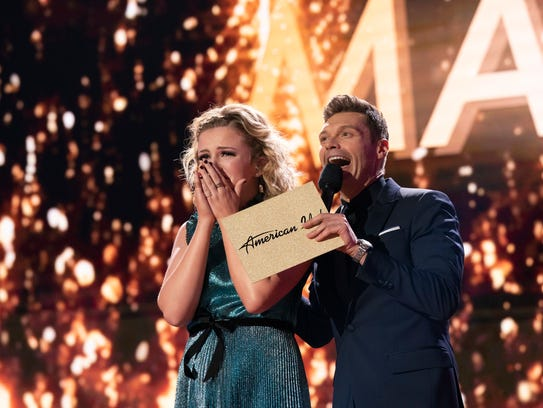 Maddie Poppe, left, reacts with Ryan Seacrest after
