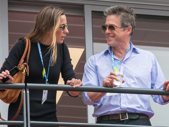 Hugh Grant and wife Anna Eberstein are seen during