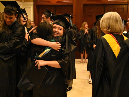 Hugs all around for new grads and their family members.