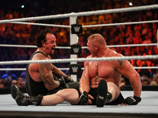 Brock Lesnar, right, and The Undertaker battle it out