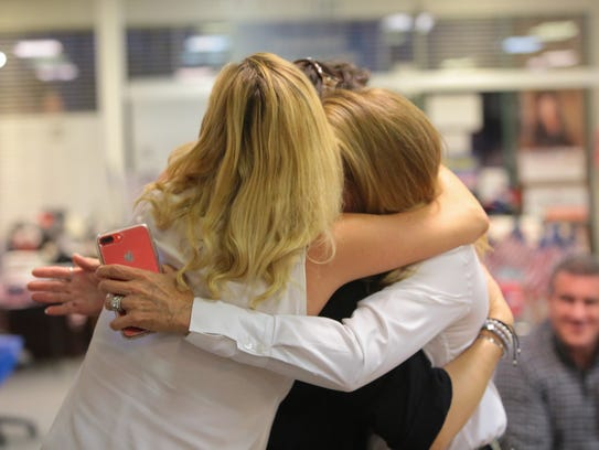 Kimberlin Brown Pelzer embraces friends after receiving news from her campaign that she will advance in the election for Congress, La Quinta, Calif., Tuesday, June 5, 2018.