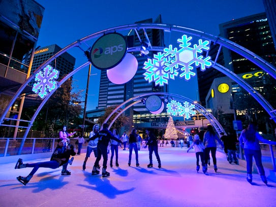 Skaters move along the ice at the CitySkate Ice Rink