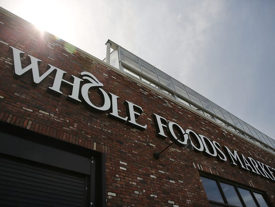 A sign for a Whole Foods Market is viewed in the Brooklyn