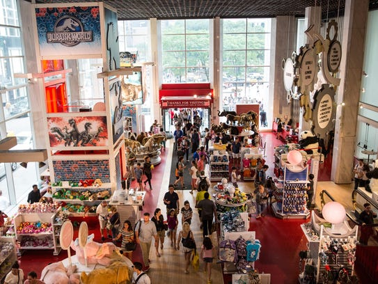 Fao schwarz toy store in nyc closing july 15 people walk through fao schwarz on july 14 2015 sciox Image collections