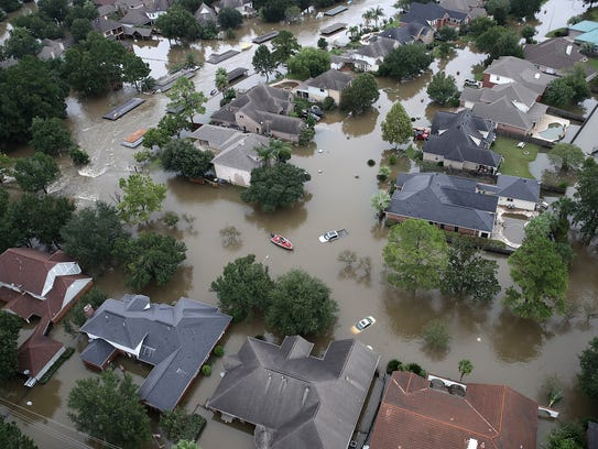 Flooded homes are shown near Lake Houston fin the aftermath