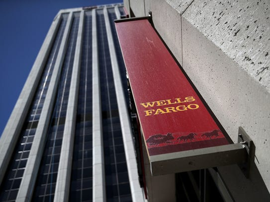 File photo taken in 2017 shows a Wells Fargo sign outside