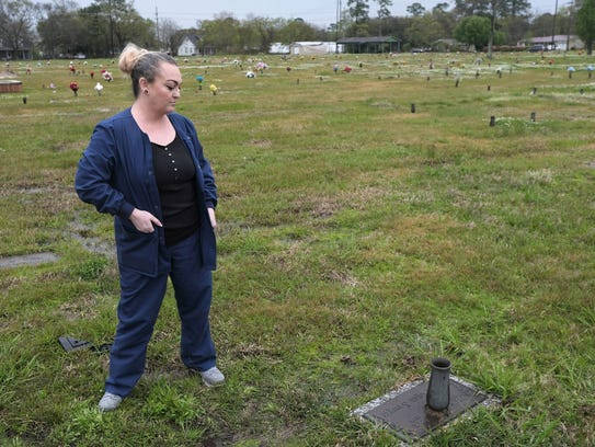 Amber Sawyer stands near her sister Donna Sawyer's