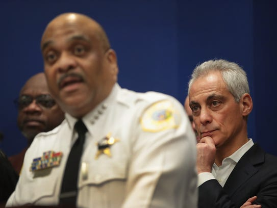 Mayor Rahm Emanuel and Police Superintendent Eddie Johnson hold a press conference flanked by community activists, local politicians and families of gun violence victims to urge Illinois Gov. Bruce Rauner to sign a gun legislation bill that has been approved by the Legislature on March 12, 2018, in Chicago.