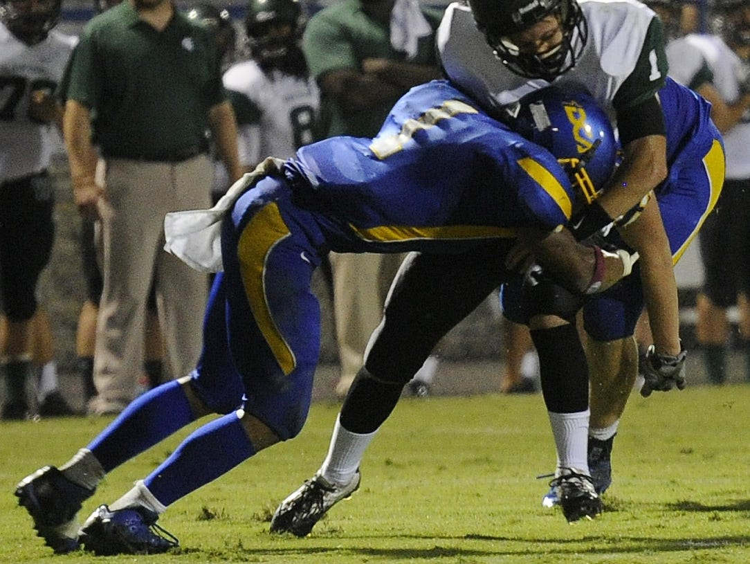 DCA's Shannon Fayne makes a tackle