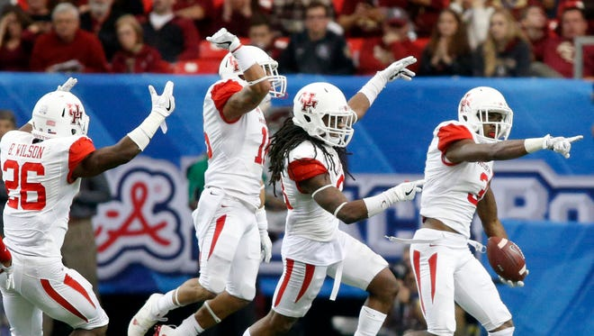 Houston Cougars cornerback William Jackson III (3) celebrates with teammates after an interception in the second quarter.