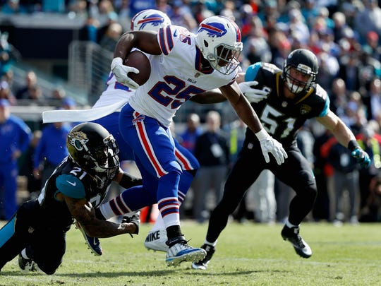 JACKSONVILLE, FL - JANUARY 07: Cornerback A.J. Bouye #21 of the Jacksonville Jaguars tackles running back LeSean McCoy #25 of the Buffalo Bills in the first quarter during the AFC Wild Card Playoff game at EverBank Field on January 7, 2018 in Jacksonville, Florida.  (Photo by Mike Ehrmann/Getty Images)