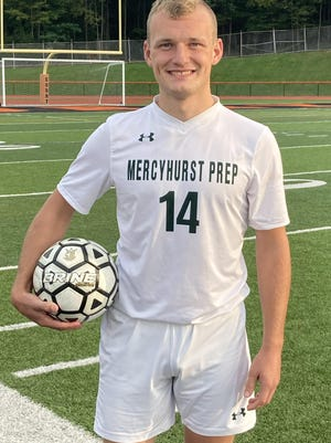 Mercyhurst Prep's Jarrett Harry poses with the game ball after scoring his team-record 112th career goal on Thursday, Sept. 17.