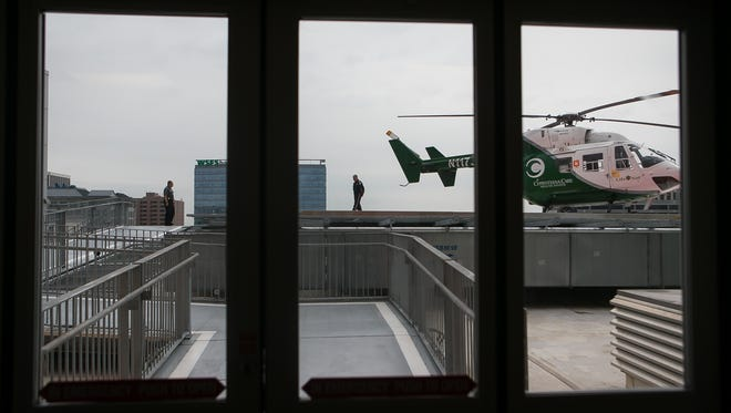 LifeNet pilot Mark Brennan stands on the helipad. Since Wilmington Hospital has been named a Trauma III health center, it now has the ability to have a helicopter pad to fly patients from Wilmington to Stanton.