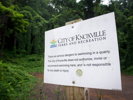A City of Knoxville Parks and Recreation sign warns visitors about the dangers of swimming in a quarry at the entrance of Fort Dickerson Quarry Park.