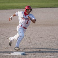 Battle Creek Bombers' Brennon Lund gets tagged out at second in Monday's game.