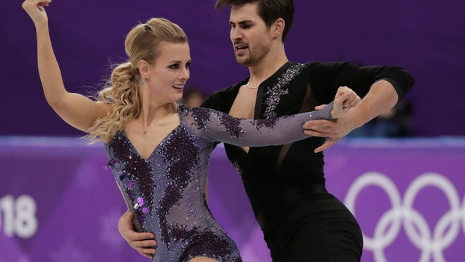 Madison Hubbell and Zachary Donohue of the United States perform during the ice dance, short dance figure skating in the Gangneung Ice Arena at the 2018 Winter Olympics in Gangneung, South Korea, Monday, Feb. 19, 2018. (AP Photo/Julie Jacobson)