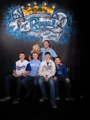 Tyler Miller, 51, his high-school sweetheart and wife of 28 years, Darcy, and their four sons.