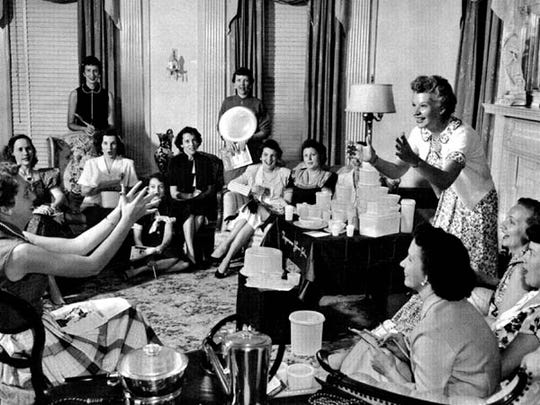 Brownie Wise tosses a bowl filled with water at a Tupperware Party in the 1950s.