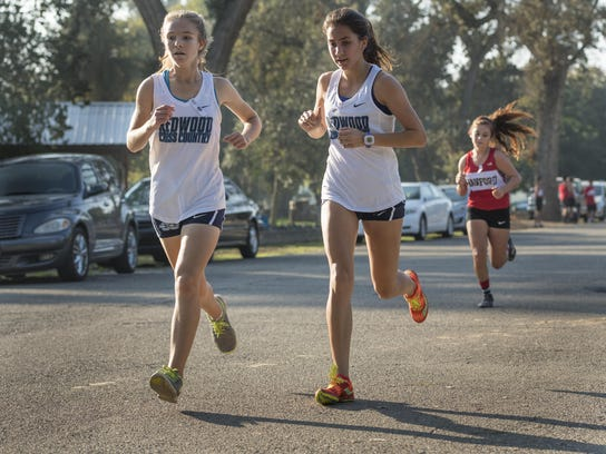 Redwood's Kate Phippen, left, and Kylee Dismuke helped
