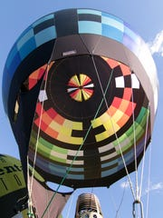 The Sullair balloon, piloted by Shawn Raya, stands
