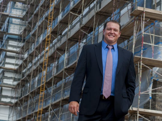 Jake Carlton, General Manager of the Creek Casino in Montgomery, Ala.  stands in front of construction of the new hotel at the site on Tuesday August 18, 2015.