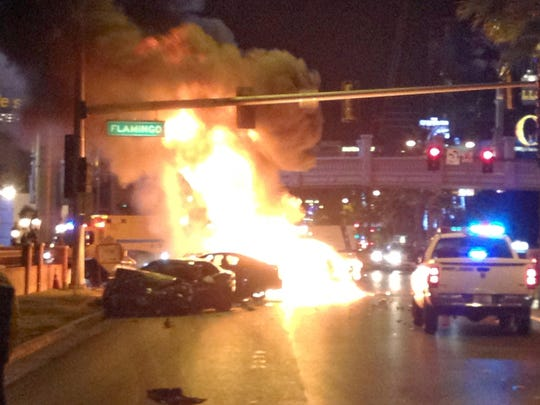 In this Feb. 21, 2013 file photo, smoke and flames billow from a burning vehicle following a shooting and multi-car accident on the Las Vegas Strip in Las Vegas.