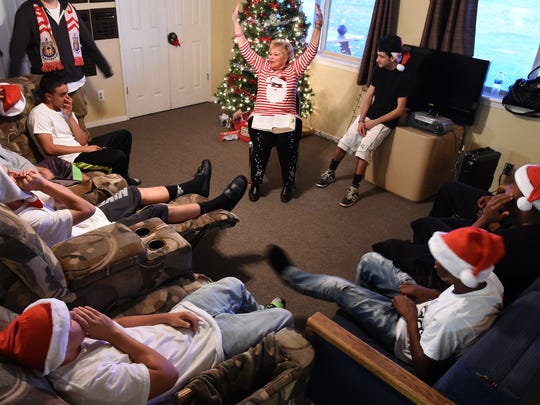 Valley Teen Ranch CEO Connie Clendenan tells the story of Jesus' birth to teen residents during the ranch Christmas party.