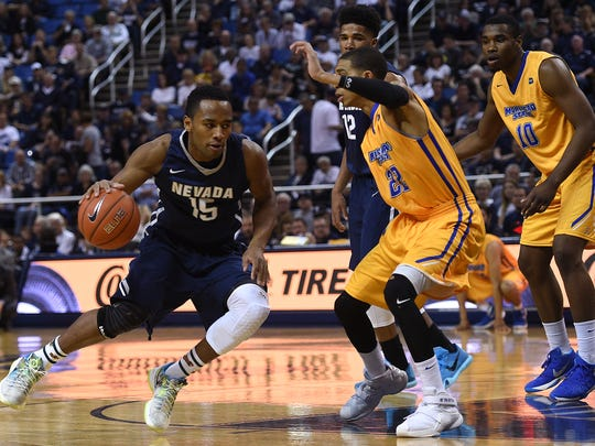D.J. Fenner drives against Morehead State last season. He helped the Wolf Pack win the CBI championship series against the Eagles.