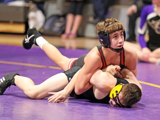 Fort Dodge freshman Drake Ayala heads for victory over