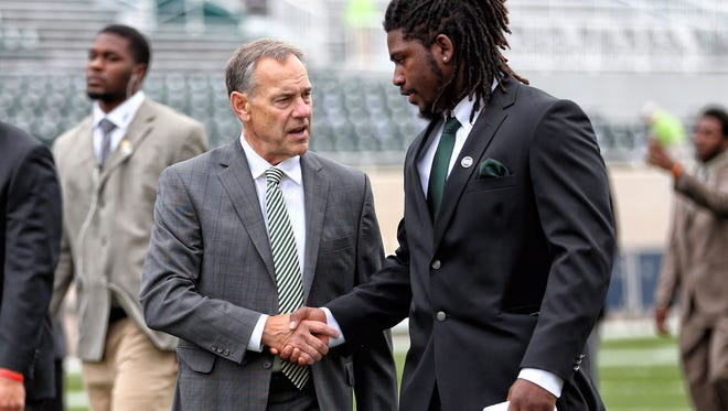 Michigan State head coach Mark Dantonio talks with former Spartans defensive end Auston Robertson before last season's game against Michigan. Robertson, facing sexual assault charges, was kicked out of the program in April.