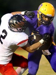 Smyrna's Casey Perkins, right, tries to shake off Stewarts