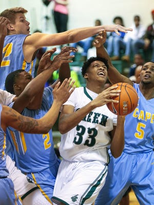 Mount Pleasant's KVonn Cramer (33) is surrounded under the basket by Cape Henlopen's Ian Robertson (top) and (from left) Jerry Harden, Cory Barnes and Randy Rickards in the first half of Mount Pleasant's 50-47 home win in the second round of the DIAA state tournament.