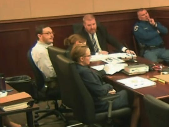 Colorado theater shooter James Holmes, far left, sits at the defense table at the opening of his trial in Centennial, Colo., Monday, April 27, 2015. The trial will determine if he'll be executed, spend his life in prison, or be committed to an institution as criminally insane. (Colorado Judicial Department via AP, Pool)