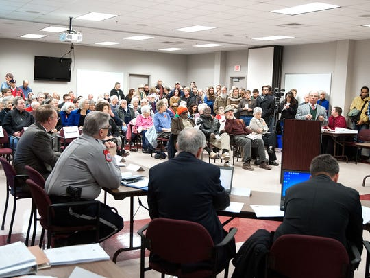 Residents pack the County Administration Center to listen to the Harrisonburg/Rockingham Community Criminal Justice Board meeting on the jail study on Dec. 8.